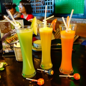 Fruit Juice Trio: passion fruit juice, carrot+apple+orange smoothies, and guava juice. Look like three ladies ;)